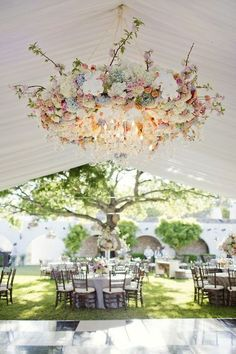 Outdoor Recption, Greenery And Floral Chandeliers Above Table.