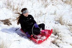 Olivia Caruso, 11, of Wildwood Crest flies down the side of a hill at Fern Road beach.