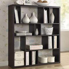 A simple, contemporary form makes the perfect blank canvas for displaying your photos, books, and other treasures. This fun but functional modern shelving unit is made with dark brown/ espresso faux wood grain paper veneer over a frame of engineered wood.