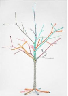 Make a yarn-wrapped tree (like this one from UO) using branches and a vase
