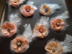 Make boutonnieres for groomsmen... like these. To match sash!