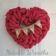 This adorable heart wreath made with hot pink burlap is accented with a burlap love banner. Wreath pictured measures at around 15- 16