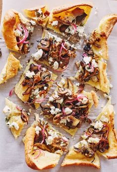 Holiday sides: Vegetarian Mixed Mushroom and Goat Cheese Yorkshire Pudding Recipe. This is one of the most delicious savory popovers you'll ever try and it's perfect for Thanksgiving because it's one of those side dishes that are perfect to feed a crowd! It's EASY to make and totally delicious with red onions, thyme, goat cheese, and cremini, shiitake, and portobello mushrooms.