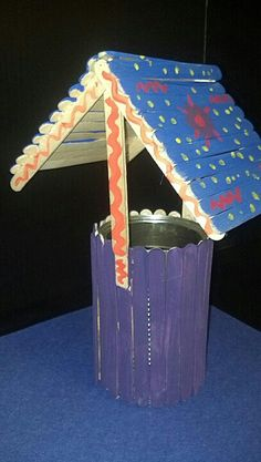 LCCC student teacher creates a wishing well with popsicle sticks and a recycled can in the Reggio inspired walkway www.lccc.edu