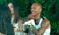 Beaming:Jeremy Meeks was all smiles as he enjoyed lunch with a couple of female companion...
