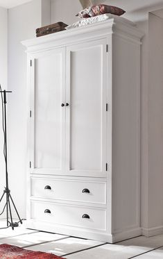 Packed with oodles of storage space, the top section of this wardrobe contains hanging space for coats, dresses, shirts and trousers and two equally spaced shelves for folded clothing, blankets and throws. Tucked away under the main closet, two generously sized drawers provide further room for knitwear and blankets or boots and shoes. Only £1075!