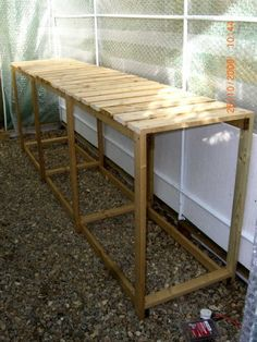 DIY garden bench for potting and growing seedlings in a greenhouse - I really like this idea! Looks like it would be very easy to make. No tutorial. Greenhouse Tables, Greenhouse Staging, Greenhouse Shelves, Greenhouse Interiors, Backyard Greenhouse, Greenhouse Growing, Small Greenhouse, Greenhouse Plans, Greenhouse Wedding