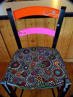 http://www.etsy.com/listing/70721126/hand-painted-funky-chairs-to-order?ref=cat1_gallery_24