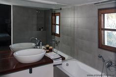 Gray bathroom with iroko vanity and wooden window, by #eNJOY architects.