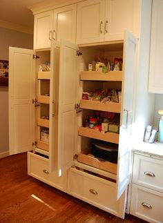 Drawers at the base of a pantry cabinet