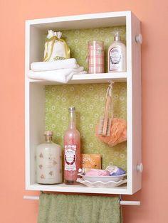 Bathroom shelf with towel bar.