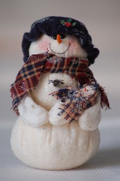 Handmade snowman by jkenning,--(I have a larger version of this and she has 2 babies with a music box inside her)!