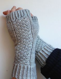 September Morning mitts are perfect for crisp fall days and the early evenings of autumn. They are truly knitter's mitts-- the Daisy Stitch pattern keeps the knitter's interest and the twisted rib and the fully fashioned thumb make for a clean fit and sharp profile. As an added bonus, they use very little yarn-- so dig out that special 50 gram skein and knit yourself a treat!