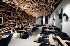 Wooden Triangles Dominate the Neutral Interior of Kido Sushi Bar by DA Architects #DAarchitects #Interior #InteriorDesign #Restaurant #Russia #walls