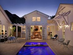 Love this outdoor room. Cozy idea on cool nights. Beautiful wood detailing. Vacation Cottage with Coastal Interiors