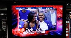 """Caption: Barack Obama and Michelle Obama are seen on the in-house television monitors during the ''Kiss Cam"""" segment at the U. men's Olympic basketball exhibition game. Anniversary Photos, 20th Anniversary, Kiss Cam, Olympic Basketball, Michelle Obama, Barack Obama, Reign, Caption, Presidents"""