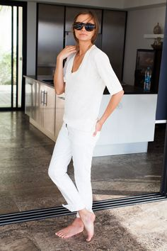 White jeans, white shirt, bare feet