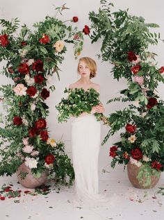 DIY Red floral wedding ceremony alter: http://www.stylemepretty.com/2015/12/16/diy-red-floral-alter-from-bows-arrows-part-i/ | Photography: Sarah Kate - http://sarahkatephoto.com/