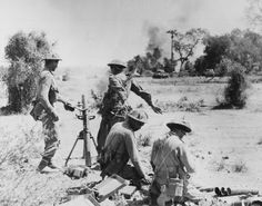 Indian mortar platoon in action supporting advancing tanks in Burma, 1945