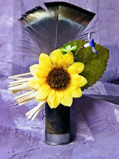 Groomsmen's boutonniere #turkey feather #shotgun shell #country #wildflower. I'd probably go for a different flower.