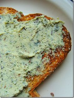 "Basil and herb cashew ""cheese"" spread. add artichokes and black olives"