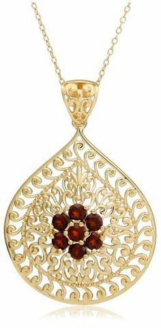"Yellow Gold Plated Sterling Silver Garnet Flower Pendant, 18"" Amazon Curated Collection-$31.99- Elegant gold detailing fills the center of this fancy teardrop-shaped pendant. Rounds of red garnet gemstone form a floral accent in the center and grant the pendant feminine appeal."