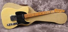 """1952 Fender® Telecaster® Blackguard (US $12.000) Nitrocellulose body and neck refinish. All hardware and wiring scheme with a blend circuit, tone cap, resistor is original. No-line Kluson® tuners, decal and black phenolic pickguard. Refretted long ago with vintage frets. 'Tadeo' model (mid '52). Neck date: TG 7-31-52, body: Tadeo 8-6-52, bridge plate: 3477. Full D shape neck. Thickness fret: .870""""/.966"""". Weigh: 7lb. 8oz. Fender, tweed 'Thermometer' case."""