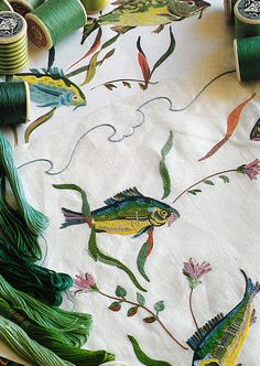 """style court:  Behind the Decoration The Porthault firm embroidered all the linen for Aristotle Onassis's yacht, Christina. Shown above, marine life serves as a unifying decorative theme. According to author Francoise de Bonneville, the execution here is """"so perfect, especially in terms of shading, that it is hard to distinguish the watercolor sketch from the final embroidered version."""""""