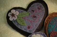 embroidered felt heart hand warmers filled with rice or fill with lavender to use as a drawer sachet