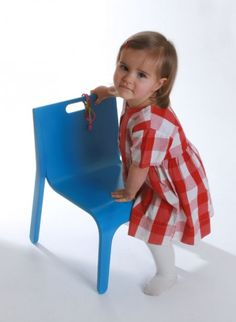 Child's chair by Alex MacDonald for the Collection Editions  Beautifully simple child's chair in bent wood, with a handle allowing for easy transportation by little hands.The chair can be stacked and is delivered assembled. Its the perfect height for the child's table.  #thecollection