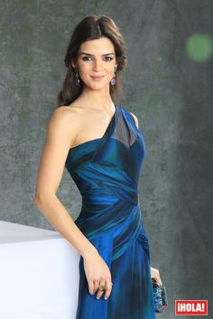 Clara Lago. I like the green/lilac earrings to complement blue dress