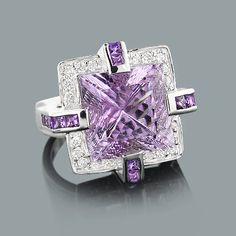 Large Amethyst Ring With Diamonds in 18K gold weighs approximately 12 grams and showcases a fabulous 9.60-carat amethyst and 0.84 carats of sparkling round diamonds. Featuring a unique design and a highly polished gold finish, this ladies diamond cocktail ring is available in 18K white, yellow and rose gold.