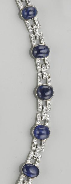 An art deco sapphire, diamond and eighteen karat white gold bracelet, J. Chaumet, Paris, circa 1925  of openwork design, with rectangular-shaped diamond-set links, each centering a collet-set cabochon-cut sapphire, joined by diamond-set bar-links, and set throughout with single-cut diamonds; signed J. Chaumet, Paris, Londres, New York, Made In France, with French assay marks; estimated total diamond weight: 3.30 carats; length: 7 1/4in