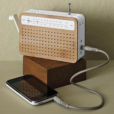 [][][] Safe Radio from West Elm. Recharges with a hand crank and can connect to an iPod/iPhone.