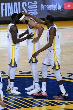 89545b549 Draymond Green and Kevin Durant of the Golden State Warriors talk with  JaVale McGee against the