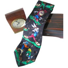 Novelty Silk Necktie Looney Tunes Mania Golfers Mens Tie Novelty Tie... ($28) ❤ liked on Polyvore featuring men's fashion, men's accessories, men's neckwear, ties, mens silk ties, mens ties, mens silk neckties, mens neck ties and mens neckties
