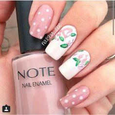 Pink polka dots with flora nail art