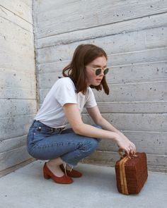 white t-shirt, jeans, red shoes, wicker purse, & retro sunglasses | street style