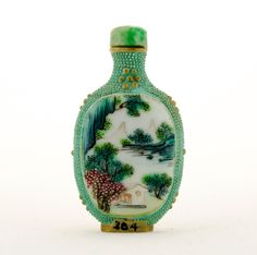 Snuff bottle, n.d., enamel and beads, 2 5/16 x 1 7/16 in. Pomona College Collection. Gift of Clinton N. Laird