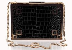 Designer Gabriella Wimmer introduces yet another never-before-seen. Here, her ultra-chic Small Marquise clutch made from black crocodile leather, 23 karat yellow gold metalwork and 12 white diamonds.