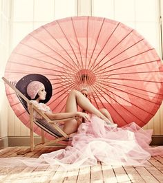 I love giant umbrellas in gardens (and this image)...perfect to relax under when the sun is too much.