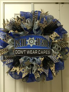 Law enforcement wreath Real Heroes don't wear capes by Twentycoats Wreath Creations Camo Wreath, Tulle Wreath, Deco Mesh Wreaths, Holiday Wreaths, Ribbon Wreaths, Wreath Crafts, Diy Wreath, Wreath Ideas, Diy Craft Projects