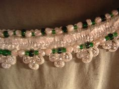 Freshwater pearls and beads added to the trim of a silk/linen cotehardie.