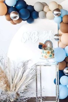 Take a look at this magical boho rainbow baby shower! The balloon decorations are fabulous! See more party ideas and share yours at CatchMyParty.com #catchmyparty #partyideas #rainbowbabyshower #rainbowparty #bohoparty #babyshower