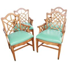 Set of Four Chinese Chippendale Fretwork Fret Arm Dining Chairs Wood Chinoiserie | From a unique collection of antique and modern chairs at https://www.1stdibs.com/furniture/seating/chairs/