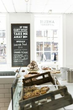 restaurant interior, love the sign...if you can't stay, take me with you...for display case