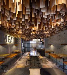 Yod Studio of Commercial Design. Timber veneer strips suspended at Shade Burger in Poltava, Ukraine. Photography by Andrey Avdeenko.
