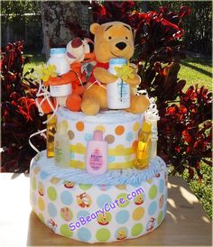 Beautiful and popular Theme!!! Winnie the Pooh and Tiger too Diaper cake.  This cake is perfectly adorable.  Also very classy looking for any baby celebration.