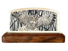 """""""Here's Looking at You"""" Color scrimshaw on ancient mammoth ivory by Gary Williams. Moody work by Williams, depicts dusk in the forest and a predator on the wing. This one almost jumps off the ivory. Very strong work mounted on a classic Fredericks stand. Size: 4 1/8""""W x 1 3/8""""D x 2 3/8""""H Price: $1,450.00 -- on ScrimshawGallery.com #scrimshaw"""