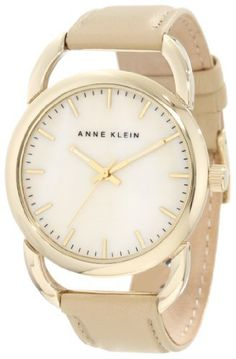 Anne Klein Women's 10/9926CMTN Gold-Tone Tan Leather Strap Watch Anne Klein. $37.77. Oversized polished gold-tone 38 mm round case. Cream colored mother-of-pearl dial with gold-tone stick markers at all hours. Luminous filled gold-tone hour and minute hands; stick second hand. Open gold-tone lugs. Cream colored leather strap with gold-tone stainless-steel buckle closure. Save 31%!